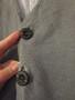 Сіра безрукавка з карманами