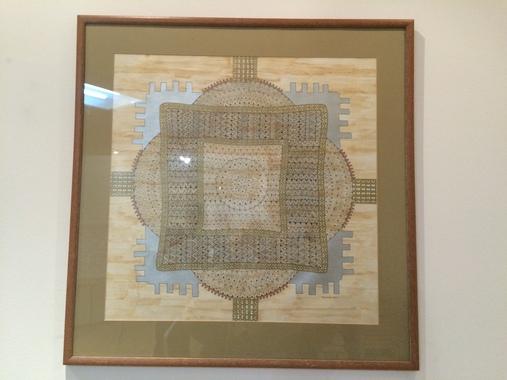 Картина зі східним орнаментом в рамці під склом
